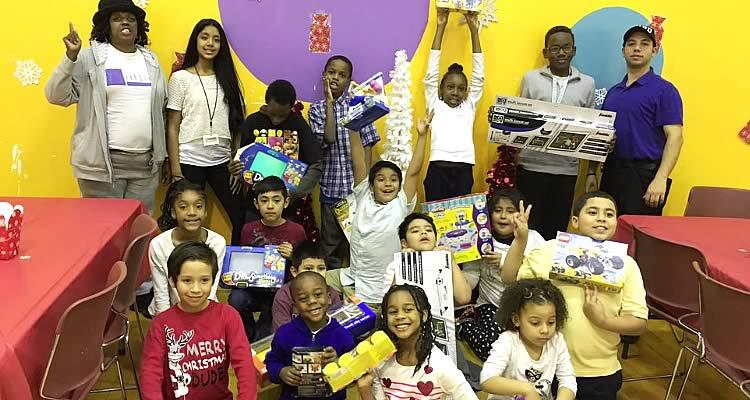 Children receiving presents presented by Elmcor